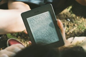 person-holding-kindle